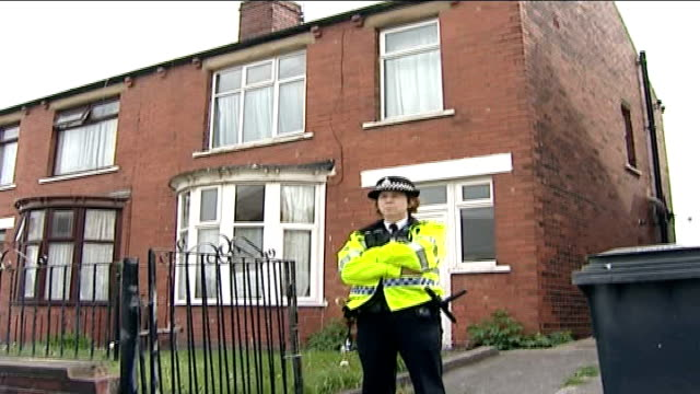 4 arrested including widow of ringleader police officer standing guard outside house police officers along in front of house - widow stock videos & royalty-free footage