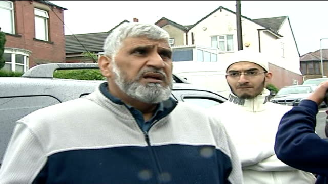 arrested including widow of ringleader; west yorkshire: dewsbury: mohammad afsar interview sot - witwe stock-videos und b-roll-filmmaterial
