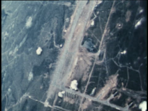 bombs explode near a wide swath of dirt, roads, and the countryside. - bomb stock videos & royalty-free footage