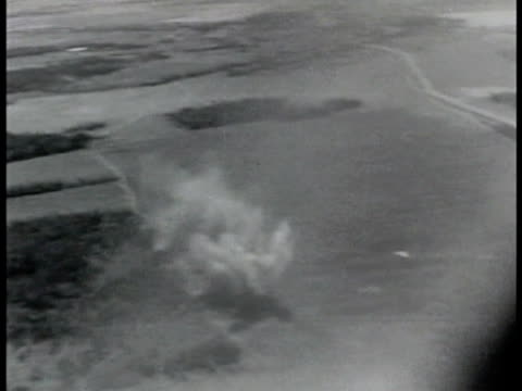 aerial bombs exploding in row near tree line air fight russian fighter airplanes in flight larger german nazi junker in flight tail smoking tracking... - tail wing stock videos and b-roll footage