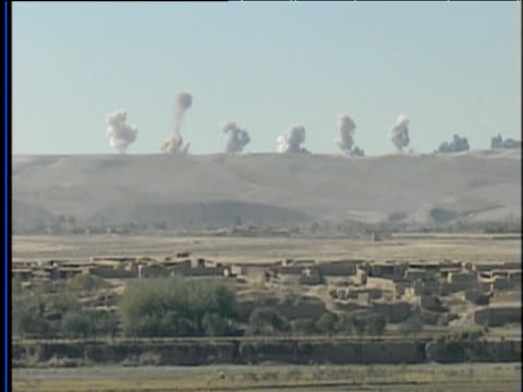 vidéos et rushes de bombs exploding on taliban areas in afghan hillsides war in afghanistan 2001 - guerre d'afghanistan : de 2001 à nos jours