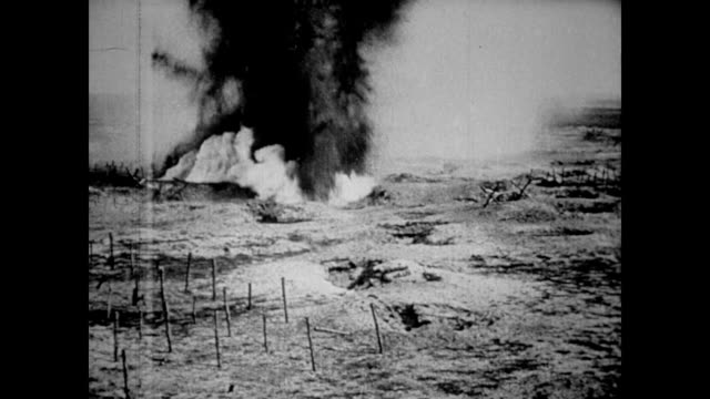 Bombs exploding over farmland no soldiers to be seen / dirt flying into the air but no signs of life WWI Battle of the Somme Bombing on July 01 1916...