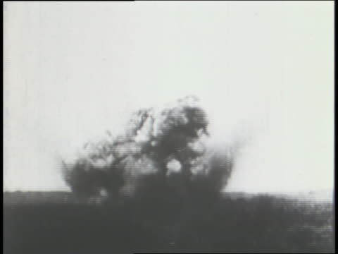 bombs fall from propeller planes during italy's campaign against ethiopia; an officer views hostilities through a telescope; medical staff carry casualties on stretchers; italian soldiers stand before a banner of dictator benito mussolini. - propeller aeroplane stock videos & royalty-free footage
