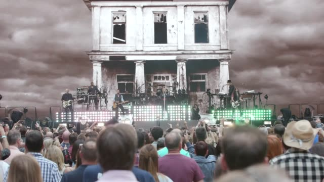 bon jovi perform on stage during the this house is not for sale tour at wembley stadium. footage of performances of this house is not for sale and... - ポピュラーミュージックツアー点の映像素材/bロール