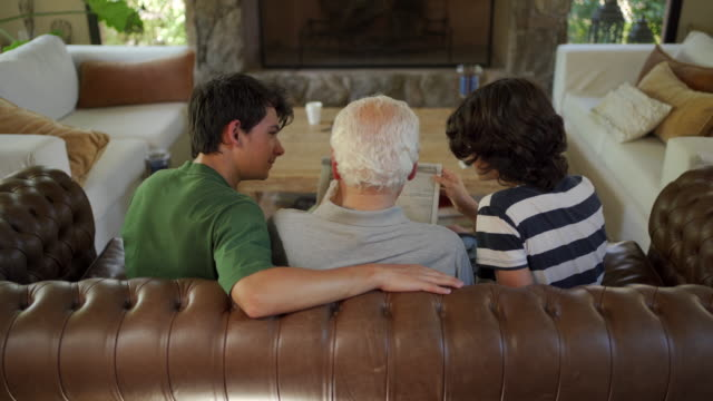 bond between grandfather and grandsons - three people stock videos & royalty-free footage