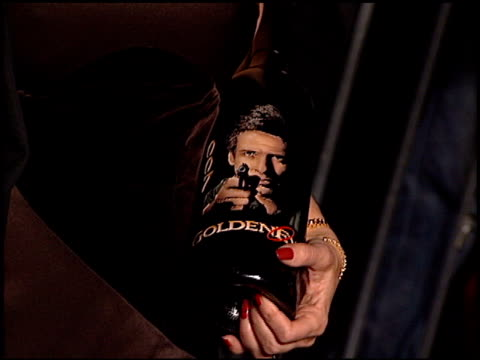 bond wine at the 'tomorrow never dies' premiere at dorothy chandler pavilion in los angeles, california on december 16, 1997. - 1997 stock-videos und b-roll-filmmaterial