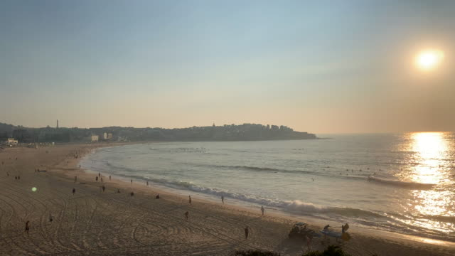bondi beach covered in smoke at sunrise on november 12 2019 in sydney australia more than 50 fires are burning across nsw with 200 homes and sheds... - bennelong point stock videos and b-roll footage