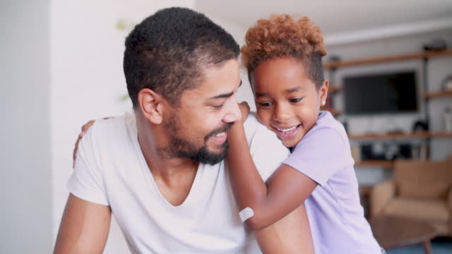 bonding between dad and daughter - plaster stock videos & royalty-free footage