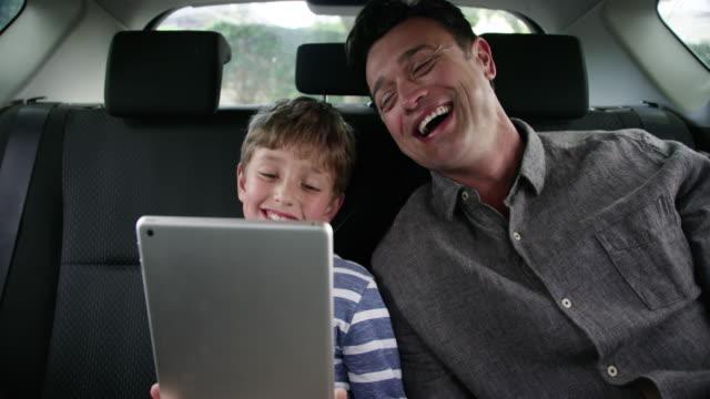 bonding during their roadtrip - car interior stock videos & royalty-free footage