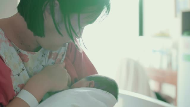 bonding moments : breastfeeding - east asian ethnicity stock videos & royalty-free footage