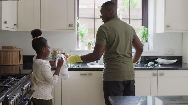 bonding over chores - genderblend stock videos & royalty-free footage