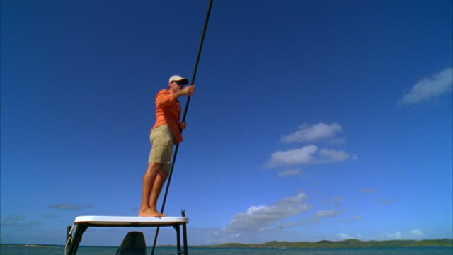 WS, LA, PAN, Bone fishing guide poling flat boat in search of  bonefish, Vieques, Puerto Rico