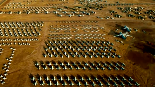 boneyard at davismonthan air force base in arizona where air force planes go after they've flown their last mission - luftwaffe stock-videos und b-roll-filmmaterial