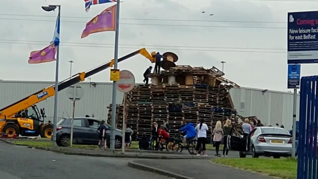 bonfire builders at avoniel leisure centre voluntarily dismantle a july 11 bonfire to remove tires after a belfast city council committee voted to... - dismantling stock videos & royalty-free footage