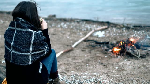 bonfire heat meets hot tea heat - cold temperature stock videos & royalty-free footage