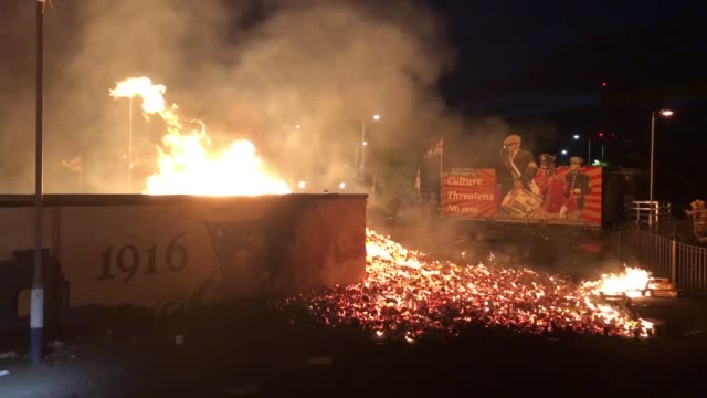vídeos de stock e filmes b-roll de bonfires have been lit in loyalist areas across northern ireland as the annual july tradition took place amid coronavirus restrictions. while there... - belfast