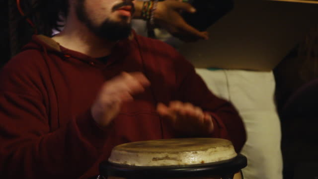 ms tu bongos to reveal man playing them  / valparaiso, chile  - one mid adult man only stock videos & royalty-free footage