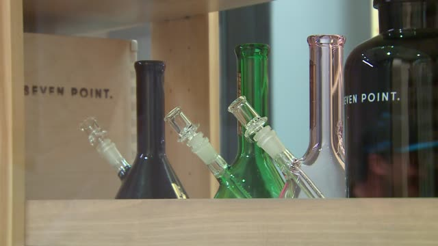 wgn bongs and pipes on display at a medical cannabis dispensary in downtown oak park near chicago on august 19 2016 - ボング点の映像素材/bロール