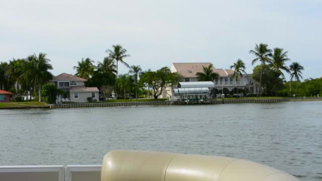 Bonita Springs Florida intercoastal waters with boat near mangroves in bay still waters