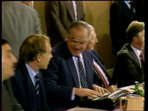 Bonn EXT Reporter to camera **BEWARE Helmut Kohl smiling press all around him Kohl waving to crowd in hall Kohl speaking HansDietrich Genscher...