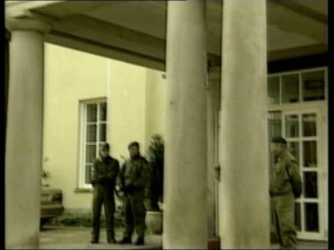 vídeos de stock e filmes b-roll de bonn petersberg hotel where afghan opposition groups are holding talks to establish an interim government for the country armed police guarding... - kandahar