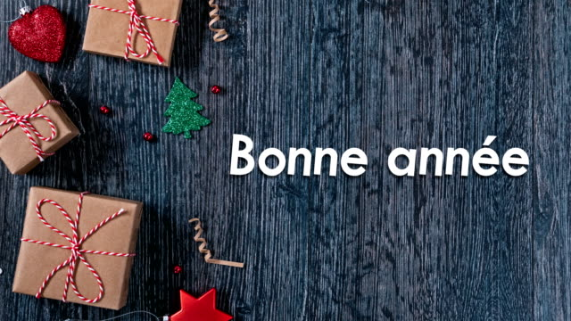 4k bonne année means happy new year in (french) loopable - conceptual symbol stock videos and b-roll footage