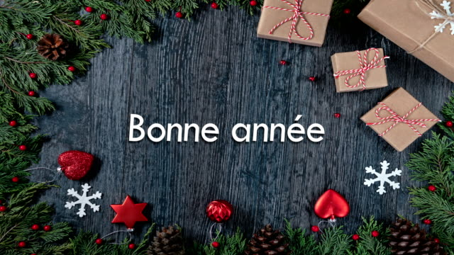 bonne année means happy new year in (french) - pinaceae stock videos & royalty-free footage
