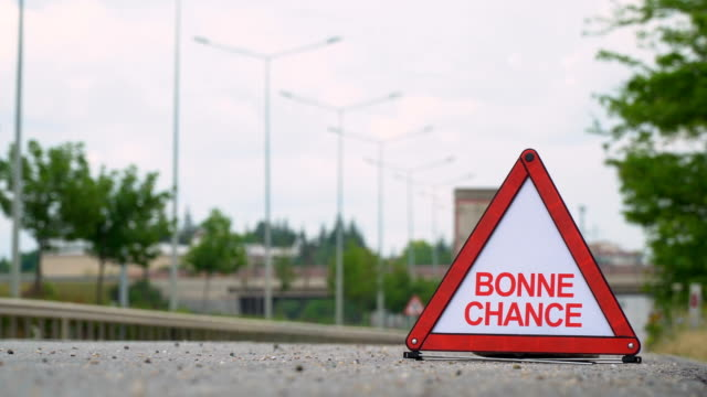 vídeos de stock e filmes b-roll de bonne chance (good luck) - traffic sign - french - sorte