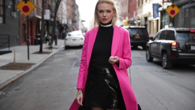 Bonnie Strange wearing a pink Topshop wool coat Saint Laurent turtleneck striped Saint Laurent boots black Saint Laurent bag Topshop vinyl skirt...