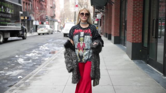 Bonnie Strange wearing red flared Zara pants boots vintage coat Gucci bag Chloe sunglasses Asos necklace on February 13 2017 in New York City