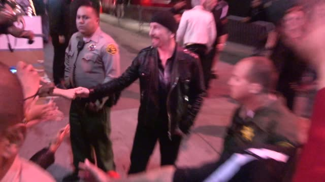 Bono and The Edge exchange greetings with fans at Secret U2 KROQ Concert at the Roxy on May 28 2015 in Los Angeles California