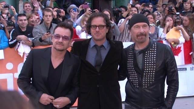 bono davis guggenheim the edge at the 2011 toronto international film festival 'from the sky down' premiere at toronto on - david 'the edge' howell evans stock videos and b-roll footage