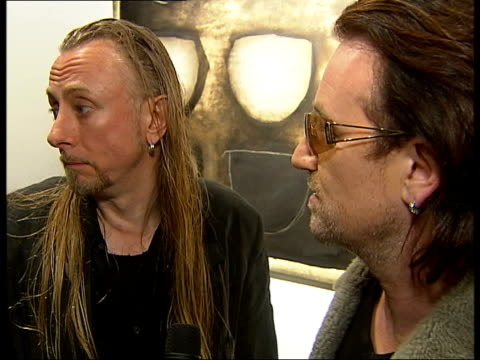 stockvideo's en b-roll-footage met bono interview sot talks about his father being a bit of painter but how art wasn't something you did / how him and guggi ended up in music and art... - jo whiley