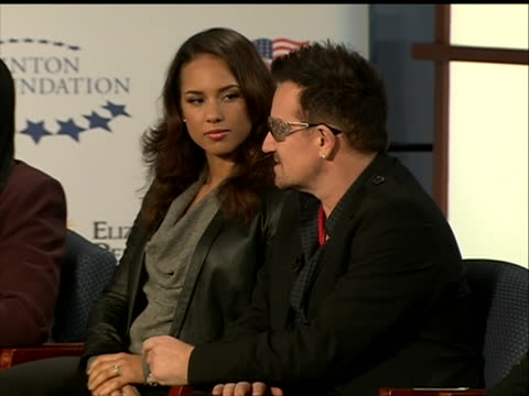bono shares with the audience on world aids day how obama's speech is monumental for the aids epidemic, both for sufferers of the disease and for... - retrovirus video stock e b–roll