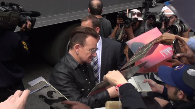 Bono with fans at the 'Late Show with David Letterman' studio in New York NY on 9/26/13