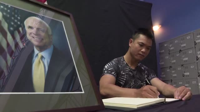 book of condolences is open at the us embassy in hanoi and flowers are laid down at the site where john mccain crashed his plane during the vietnam... - john mccain stock videos & royalty-free footage