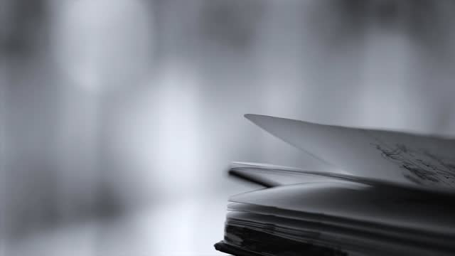book pages quickly turned over by the wind - page stock videos & royalty-free footage