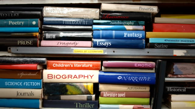 book shelf genres of literature - stack stock videos & royalty-free footage