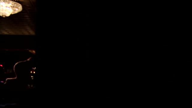 vídeos de stock e filmes b-roll de book shelf w/ books on door disguised as book shelf closing from behind it towards room w/ wood floors round chandelier lights door opening to room... - bar clandestino