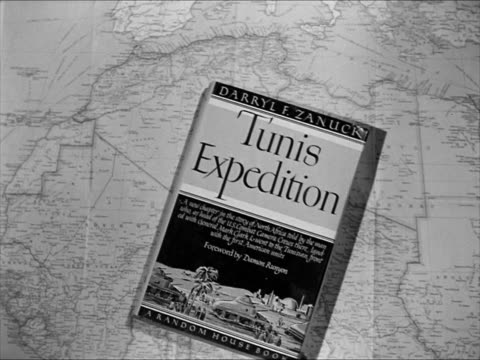 book 'tunis expedition' by studio producer colonel darryl f. zanuck. colonel darryl f. zanuck in uniform filming a fire in africa. - producer stock videos & royalty-free footage