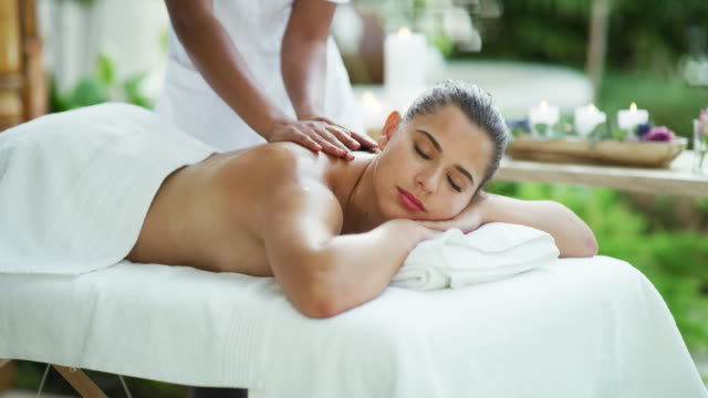 book your day to enjoy some total relaxation - spa treatment stock videos & royalty-free footage