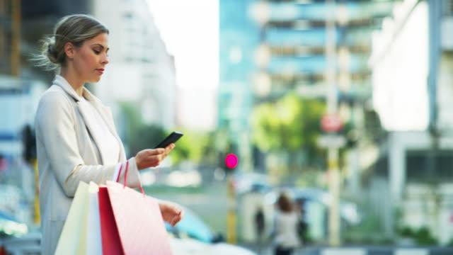 booking my taxi home - abbigliamento elegante video stock e b–roll