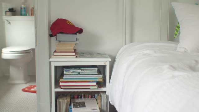 cu books and baseball cap on night table in boy's room, scarborough, new york, usa - baseball cap stock videos & royalty-free footage
