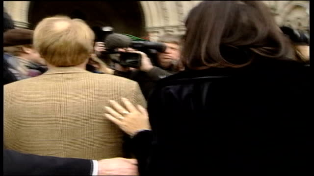 da vinci code author wins court case; dan brown out of car and past press towards high court slow motion general view of royal courts of justice and... - author stock videos & royalty-free footage
