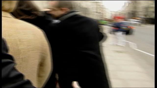 books da vinci code court case; brown gives evidence; tx 27.2.2006 england: london: high court: ext dan brown out of car then along thru' press scrum... - the da vinci code stock videos & royalty-free footage