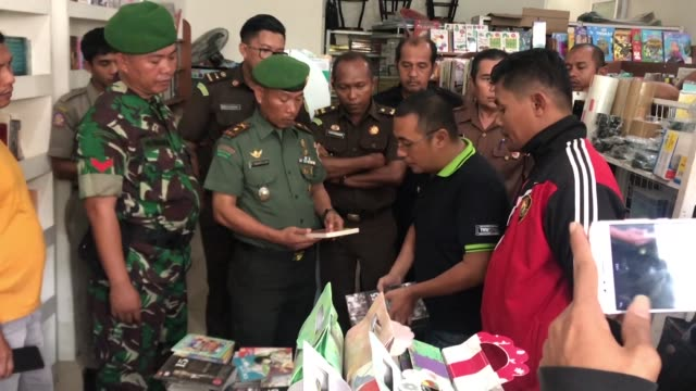 bookseller yanto tjahaja was tending to his shop when soldiers burst through the door and confiscated a dozen titles over claims they violated one of... - bookseller stock videos and b-roll footage