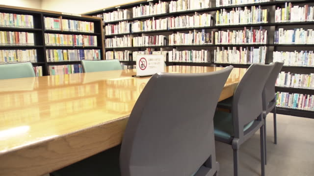 bookshelves and reading area in library, tokyo, japan - literature stock videos & royalty-free footage