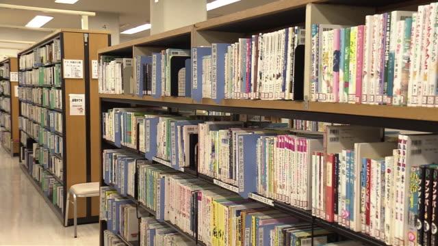 bookshelves in library, tokyo, japan - literature stock videos & royalty-free footage