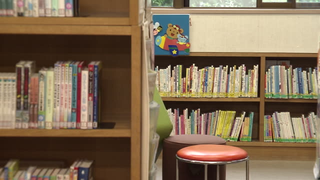 bookshelves in library, tokyo, japan - bookshelf stock videos & royalty-free footage