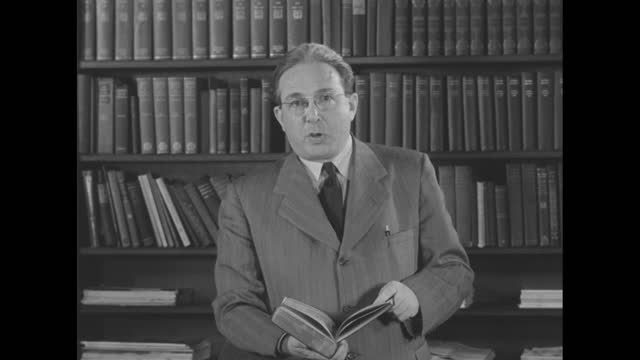 bookshelves with globe in foreground; dr. leo szilard, physicist, university of chicago, walks into frame and selects book from shelf, turns and... - danger stock videos & royalty-free footage